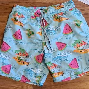 Mens blue with tropical pattern swim trunks